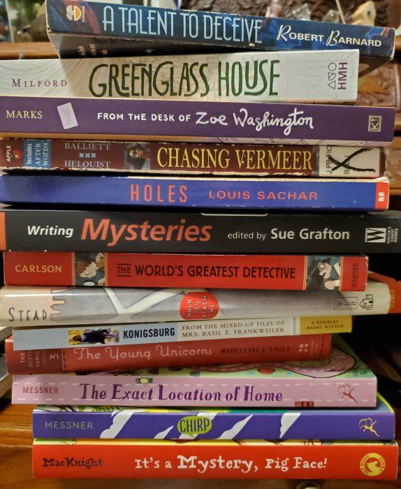 Stack of mystery novels.